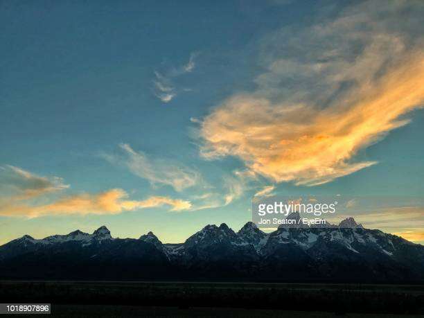 view of snowcapped mountain against cloudy sky - beaver creek colorado stock pictures, royalty-free photos & images