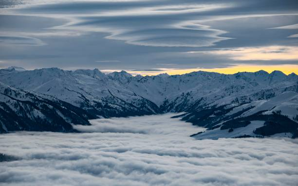 View of snow-covered mountain peaks from the summit of the Hohe Salve, high fog in the valley, Hochbrixen, Brixen im Thale, Tyrol, Austria