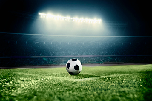 View of soccer ball on athletic field in stadium arena 637298374
