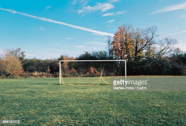 view of soccer field against sky - soccer goal stock pictures, royalty-free photos & images