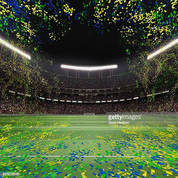 view of soccer field, goal and stadium with confetti in sky - fifa world cup stock pictures, royalty-free photos & images