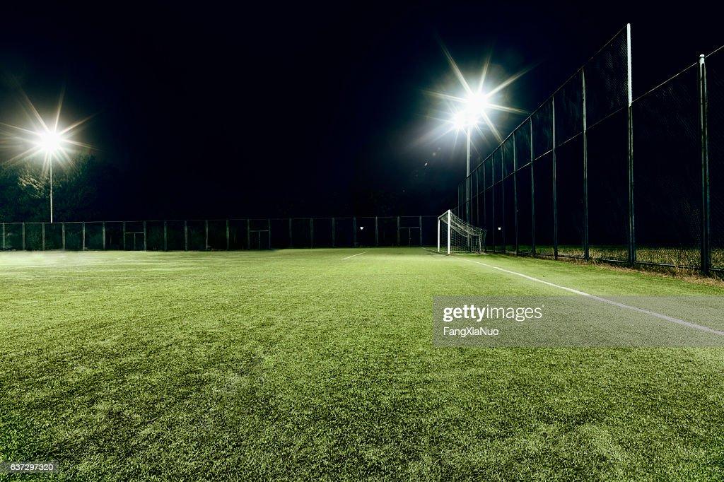 View of soccer field illuminated at night : Stockfoto