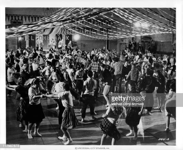 View of sock hop dance by teenagers in a scene from the film 'American Graffiti', 1973.