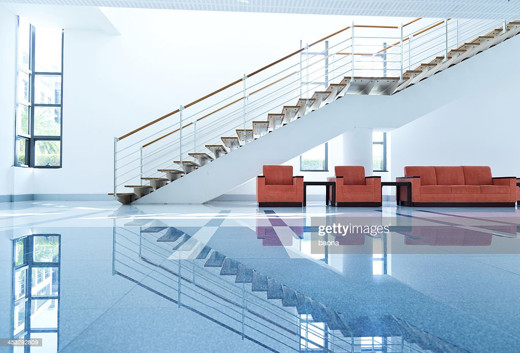 View of sofas and red chairs for people to rest on : Stock Photo