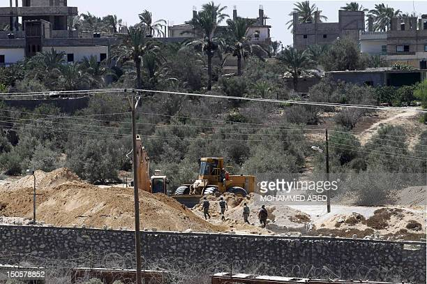 A view of soldiers from the Egyptian army destroying the infraestructure of smuggling tunnels along the EgyptGaza border is seen from Rafah southern...