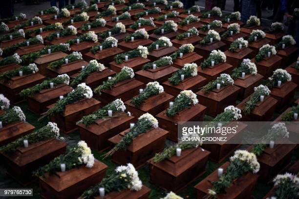 TOPSHOT View of some of the 172 urns containing the remains of victims of the Guatemalan armed conflict before being buried in San Juan Comalapa...