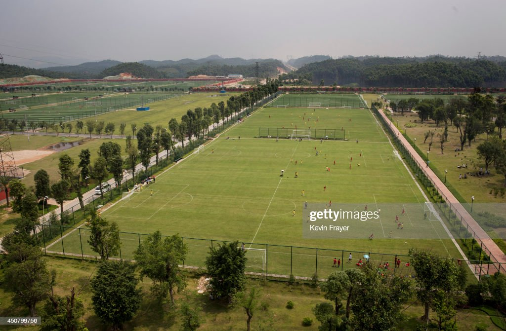 A view of some of the 50 pitches at the at the Evergrande International Football School on June 14, 2014 near Qingyuan in Guangdong Province, China. The sprawling 167-acre campus is the brainchild of property tycoon Xu Jiayin, whose ambition is to train a generation of young athletes to establish China as a football powerhouse. The school is considered the largest football academy in the world with 2400 students, more than 50 pitches and a squad of Spanish coaches through a partnership with Real Madrid.