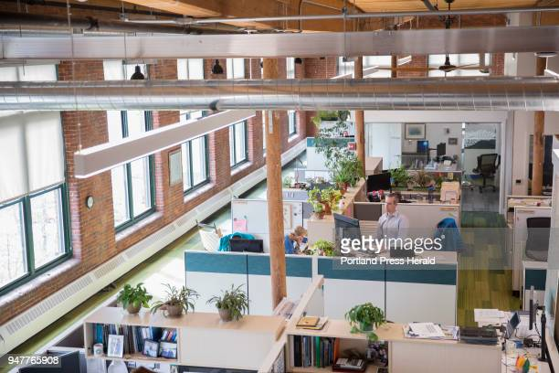 A view of some of the new open concept office space at the Nature Conservancy's office at Fort Andross in Brunswick The company completely overhauled...
