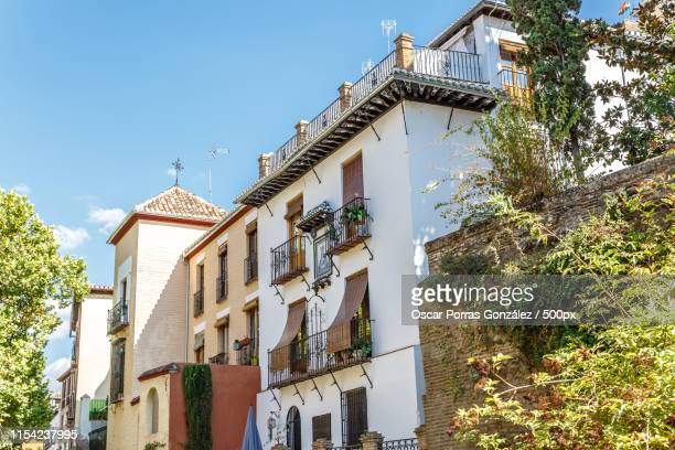 view of some old buildings in a city in southern spain - granada spain landmark stock pictures, royalty-free photos & images