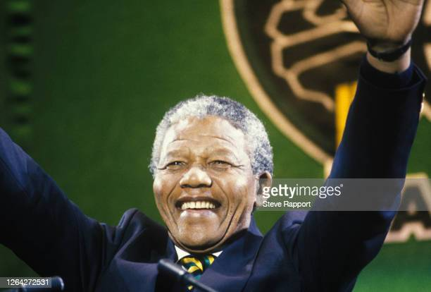 View of South African politician Nelson Mandela as he waves from the stage during the 'Nelson Mandela: An International Tribute for a Free South...