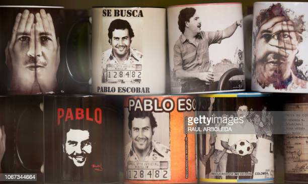View of souvenirs with the image of the late Colombian drug lord Pablo Escobar for sale in a hairdresser's at Pablo Escobar neighborhood on November...