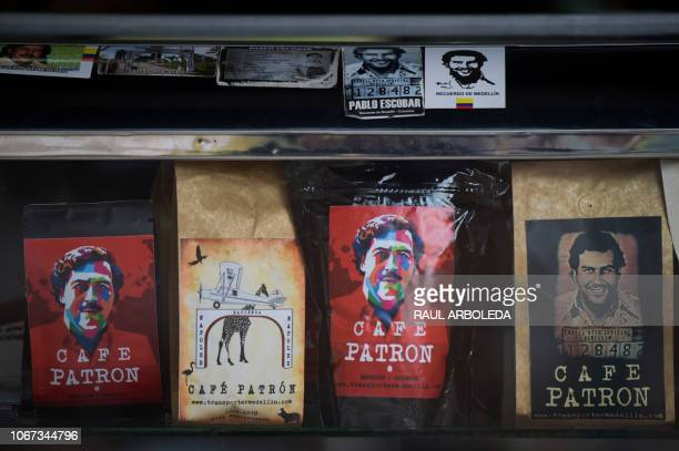 View of souvenirs with the image of the late Colombian drug lord Pablo Escobar for sale in a hairdresser's at Pablo Escobar neighborhood, on November...