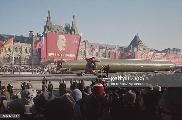 View of Soviet ballistic missiles being transported along the route of a military parade through Red Square and past the GUM department store in...