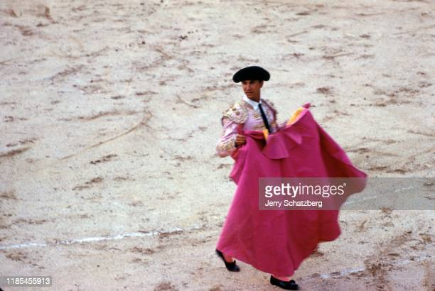 View of Spanish bullfighter Luis Miguel Dominguin with his capote de brega as he stands in Arles Amphitheater Arles France 1959