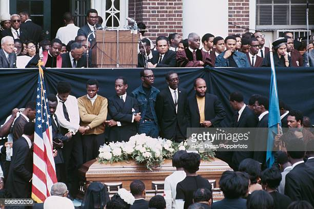 View of speakers and mourners at the funeral of assasinated American minister and civil rights leader Martin Luther King with mourners including...
