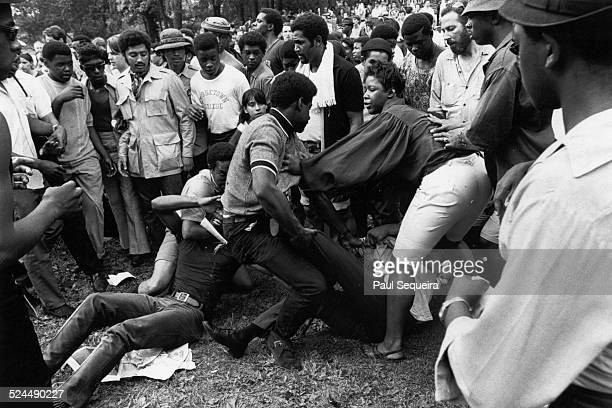 View of speakers attacked by suspected police provocateurs during a Black Panther Party rally at Lincoln Park Chicago Illinois 1969