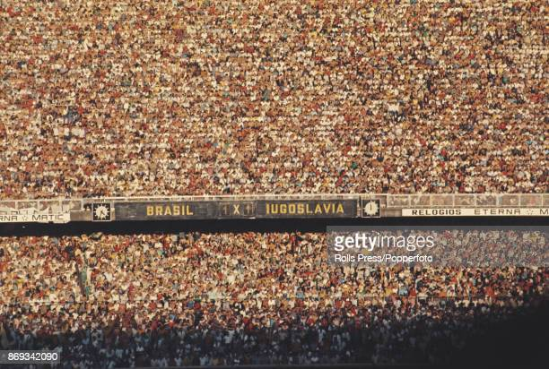 View of spectators and fans watching play between Brazil and Yugoslavia in their international friendly match at the Maracana Stadium in Rio de...