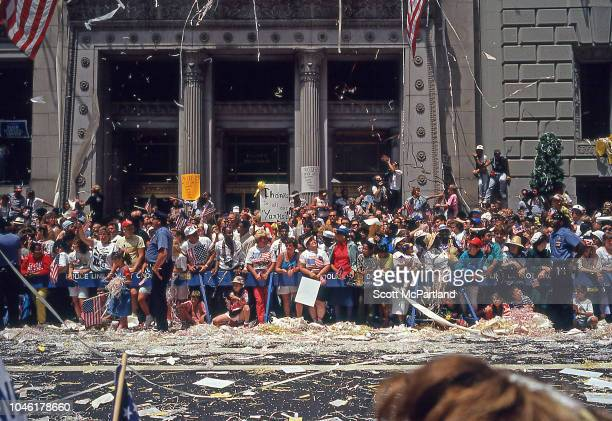 View of spectators as they stand behind NYPD barricades on Broadway's Canyon of Heroes during a ticker tape parade for Desert Storm veterans New York...