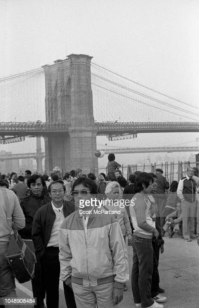 View of spectators at Lower Manhattan's South Street Seaport during the Brooklyn Bridge's 100th birthday celebrations New York New York May 24 1983