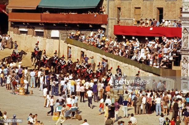 View of spectators in the Piazza del Campo for the Palio Di Siena horse race Siena Italy August 16 1968 The twiceannual race pits horses and riders...