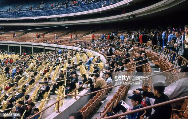 View of spectators in the stands of opening day at Shea Stadium New York New York April 17 1964 The day marked both the opening day of the season and...