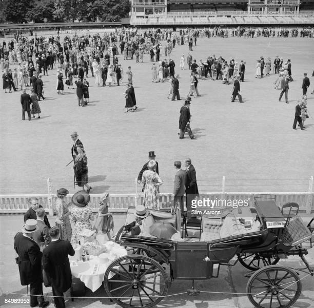 A view of spectators on the pitch at a cricket match between the public schools of Eton and Harrow at Lord's Cricket Ground London 1955