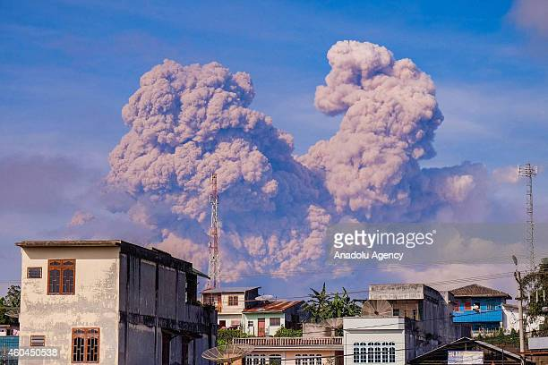 A view of spewing pyroclastic flow from Mount Sinabung volcano eruption is seen from Siosar village on December 14 2014 in Karo district North...