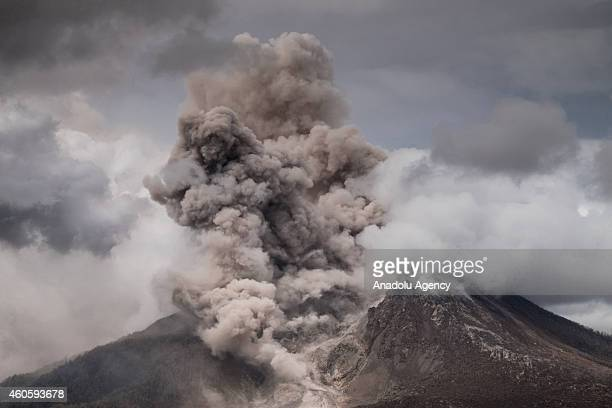 A view of spewing pyroclastic flow from Mount Sinabung volcano eruption seen from Kabanjahe village on December 17 2014 in Karo North Sumatra...
