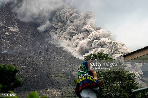 A view of spewing pyroclastic flow from Mount Sinabung volcano is seen from Kuta Tengah Villages on June 16 2015 in Tanah Karo North Sumatra...