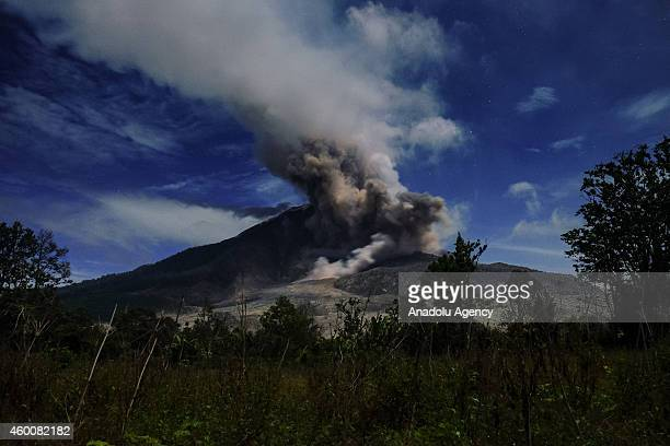 A view of spewing pyroclastic flow of Mount Sinabung volcano eruption is seen from Gamber village on December 06 2014 in Karo North Sumatra Indonesia