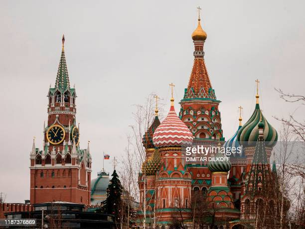 A view of St Basil's Cathedral and the Kremlin's Spasskaya Tower in downtown Moscow on December 9 2019 Russia will miss next year's Tokyo Olympics...