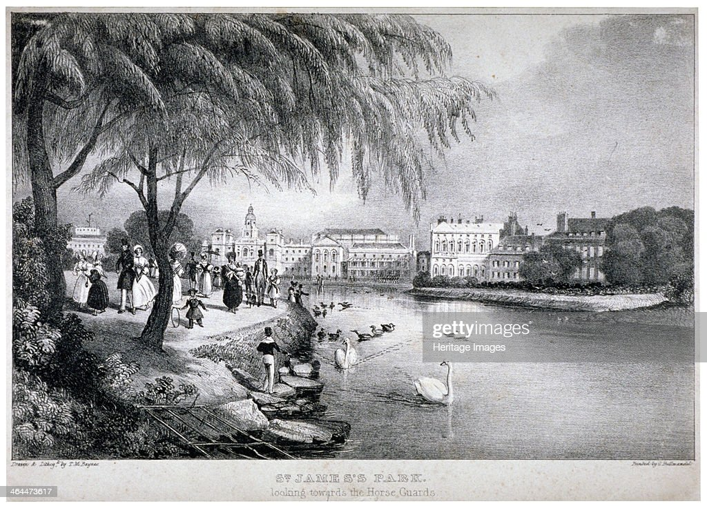 View of St James's Park and Buckingham Palace, Westminster, London, c1830. In the foreground figures amble through the park and by the water's edge two swans watch the approach of a boy.