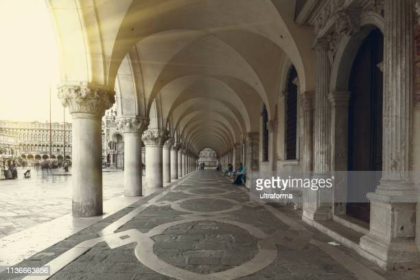 view of st mark's square and the colonnade of doge's palace in venice at sunset - veneto stock pictures, royalty-free photos & images