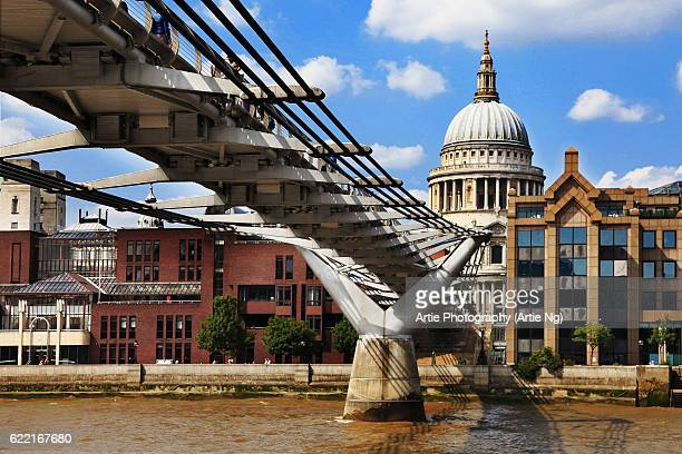 View of St Paul's Cathedral and the Millennium Bridge at River Thames, London, England