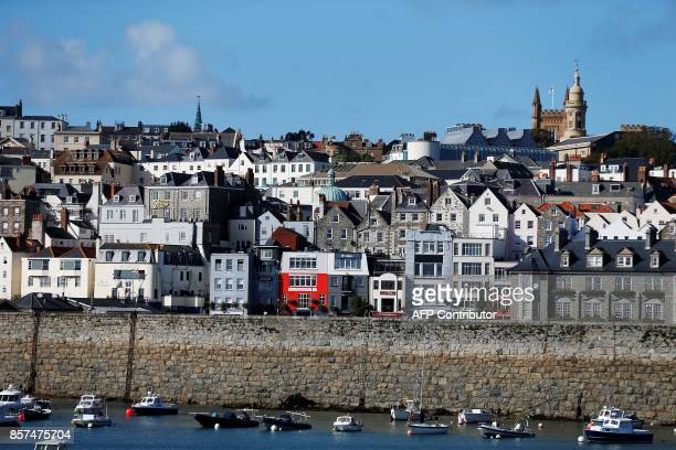 View of St. Peter Port in Guernsey in the Channel Islands on October 3, 2017. / AFP PHOTO / CHARLY TRIBALLEAU