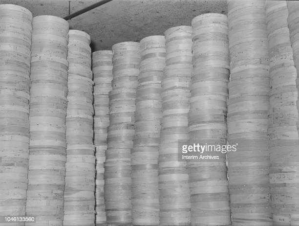 View of stacks of cheese in cicrular containers in a cold storage warehouse Jersey City New Jersey April 1939