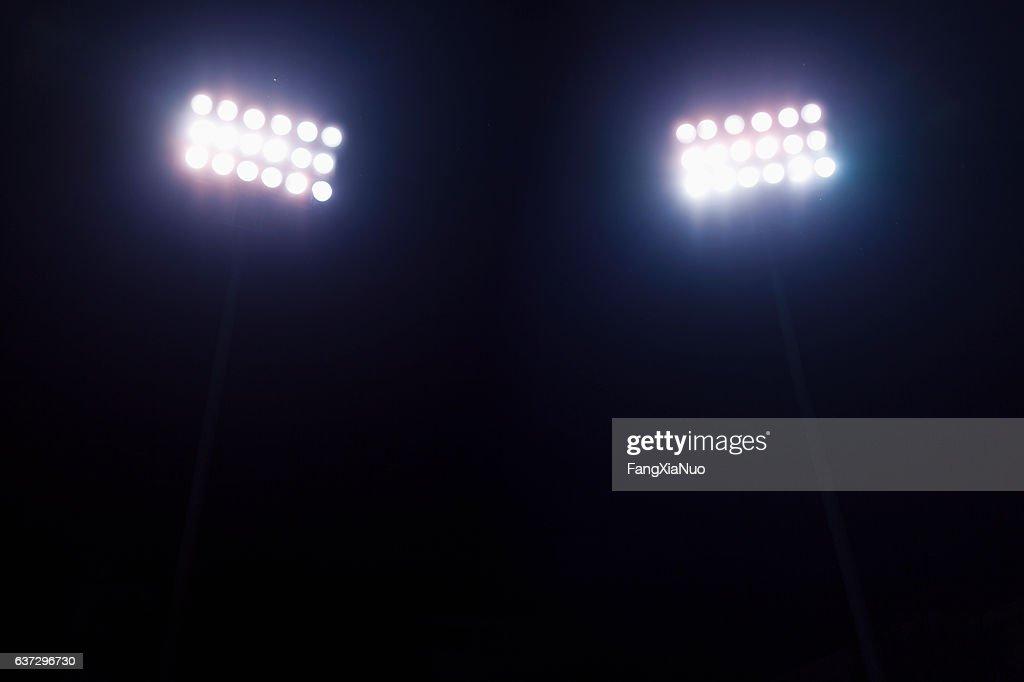 View of stadium lights at night : Stock Photo