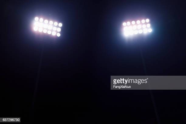 view of stadium lights at night - spotlit stock pictures, royalty-free photos & images