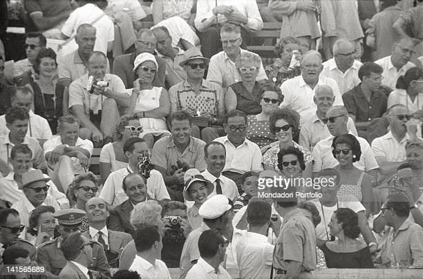 View of stands of the Olympic Stadium in Rome, among the public that watch, armed with a camera and a binoculars, to Olympies Competitions, there are...