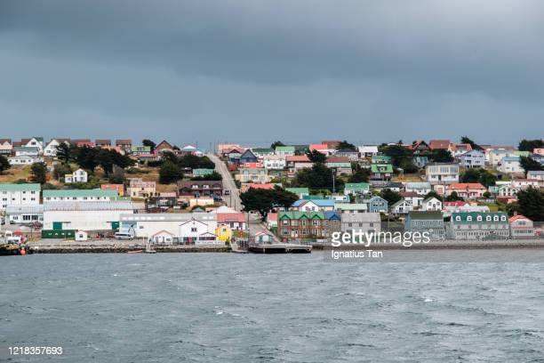 view of stanley, falkland islands from stanley harbour - island stock pictures, royalty-free photos & images