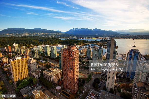view of stanley park, vancouver harbour, english bay and the surrounding skyscrapers and mountains, vancouver, british columbia, canada - stanley park vancouver canada stock pictures, royalty-free photos & images