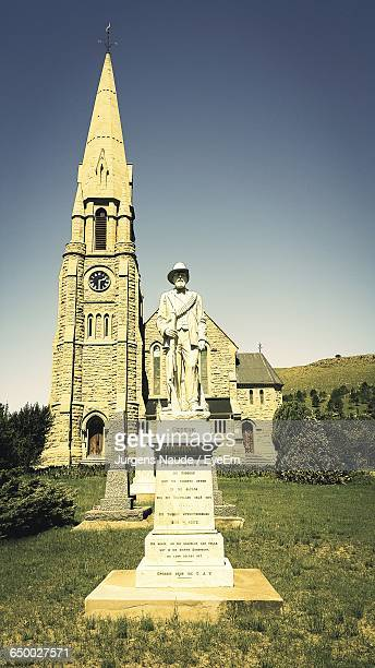 View Of Statue Against The Church