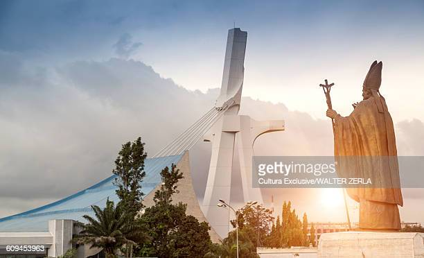 view of statue and st pauls cathedral, abidjan, ivory coast, africa - abidjan stock pictures, royalty-free photos & images