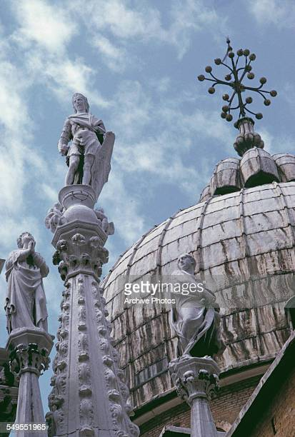 A view of statues and a dome roof in Vatican City circa 1960