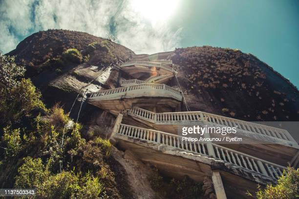 view of steps on mountain against sky - guatapé stock pictures, royalty-free photos & images