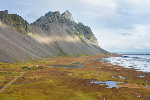 View of Stokksnes beach, with Vesturhorn and Vestrahorn in distance, Stokksnes, East Iceland, Iceland - gettyimageskorea