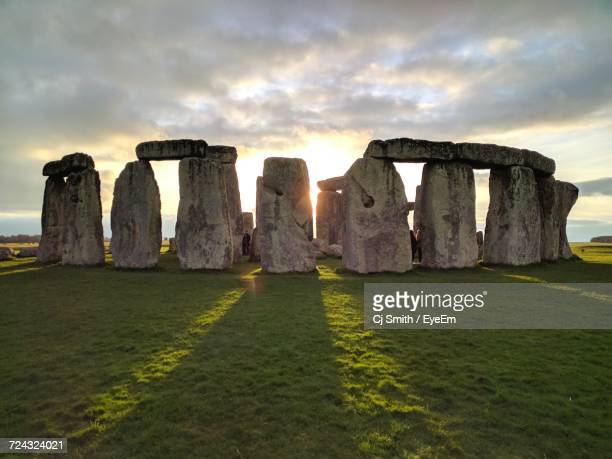 view of stonehenge at sunset - stonehenge stock photos and pictures