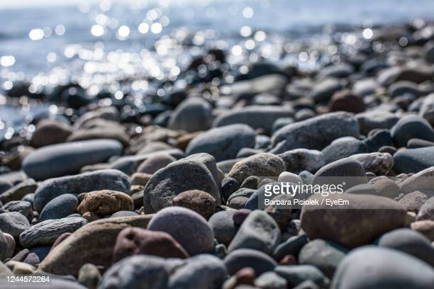 view of stones at beach - pebble stock pictures, royalty-free photos & images