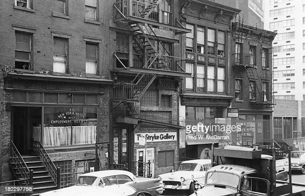 View of store fronts on 10th E Street New York New York August 23 1963 Among the visible businesses are the New York Hotel Employment Agency The...