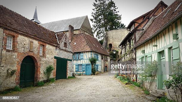 view of street along buildings - hauts de france stock photos and pictures